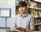 A happy student at Taylors High School is taking advantage of its library